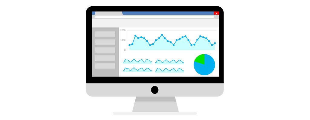 Mac-Monitor mit Charts als Symbolik für Software und Tools